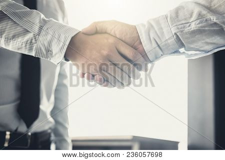 Handshake After Good Cooperation, Two Businessman Handshake After Discussing Good Deal Of Trading Co