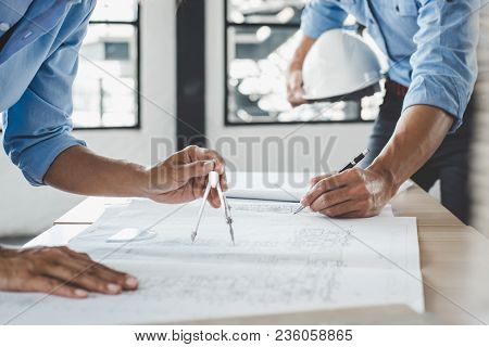 Hands Of Architect Or Engineer Working On Blueprint Meeting For Project Working With Partner On Mode