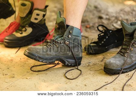 Holidays Trip Camping Tourism Relax Trekking Concept. Girl And Boy Compare Footwear. Hiking Couple E