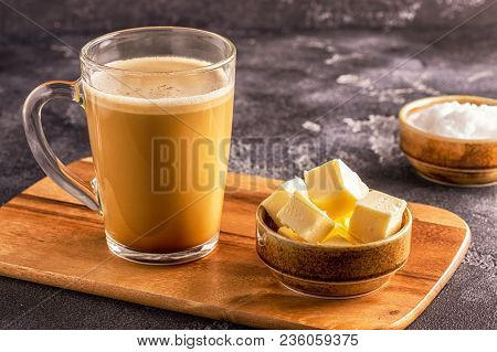 Bulletproof coffee, blended with organic  butter and MCT coconut oil, paleo, keto, ketogenic drink breakfast. poster