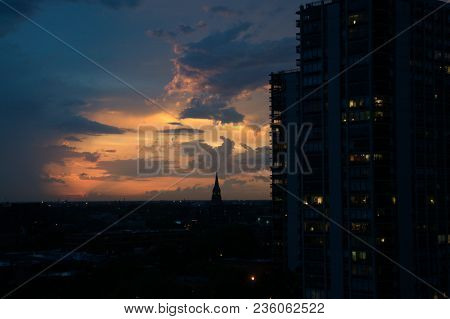 Breathtakingly Beautiful Pink And Orange Sunset With The Dark Silhouette Of A Church Steeple And Con