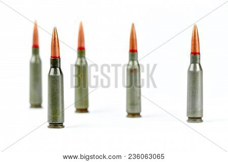 Bullets From Kalasnikov Ak-47 Rifle Ammunition Closeup, Isolated On White Background.
