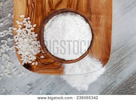 Gluten Free Rice Flour In Wooden Bowl With Rice On Wooden Table From Above. Celiac Disease Concept.