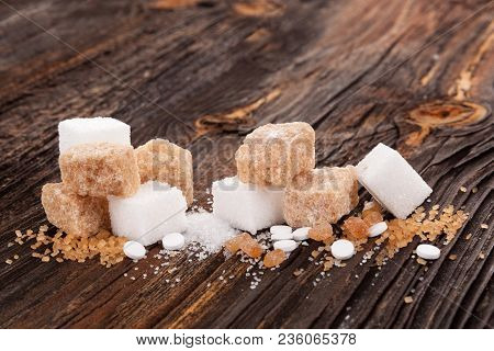 Various Types Of Sugar - Brown, White, Crystal, Cane And Artificial Sweeteners On Wooden Table.