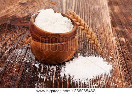 Healthy Wheat Flour In Wooden Bowl On Wooden Table.