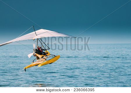 Motorized Hang Glider With Muslim Woman Take Off Frow Sea In Sunny Summer Day. Muslim People Having