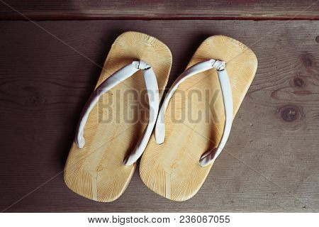 Traditional Japanese Sandals Shoes Over Wooden Background