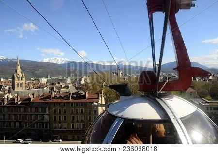 Grenoble Eggs Aerial Tram : City Overview Panorama Landscape Upon Town, Buildings, And Snowed Mounta