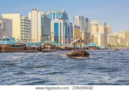 Dubai, United Arab Emirates - May 3, 2013: A Traditional Dhow Ferry Along Dubai Creek. The Creek Div