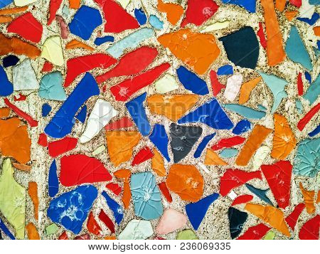 Seamless Abstract Textured Background Of Mosaic Multi Colored Stones Of Different Shapes On The Wall