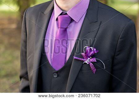 White Boutonniere Groom Closeup. Claret Bow Tie Close-up