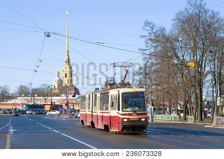 Saint Petersburg, Russia - April 07, 2018: Tram 6 Of The Route Against The Spire Of The Peter And Pa