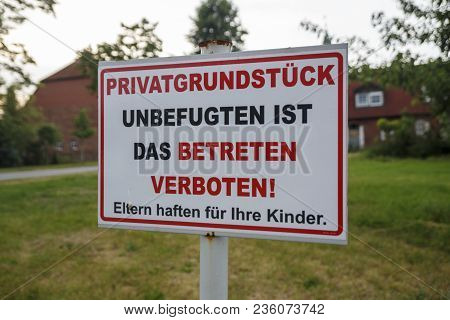 Keep Out Sign In German Saying: Private Property, Trespassing Is Forbidden And Parents Are Liable Fo