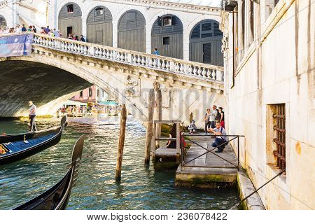 Venice, Italy - June, 21, 2013: View Of Gondola On Grand Canal And Ponte Di Rialto, Many Tourists On