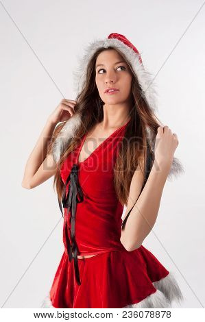 Young Beautiful Christmas Woman Over White Background