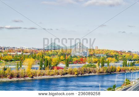 Jacques-cartier Bridge In Montreal, In Automn With The Biodome In Foreground. Montreal, Quebec, Cana