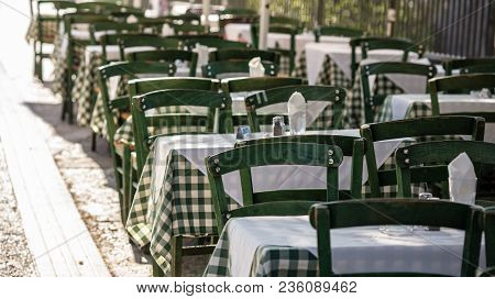 Athens, Greece. Greek Tavern Empty Tables And Chairs At Plaka.