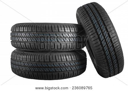 New And Unused Car Tires Against White Isolated Background