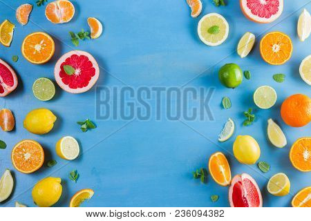Citrus Food Top View Flat Lay Borders Pattern On Blue Background - Assorted Citrus Fruits With Mint