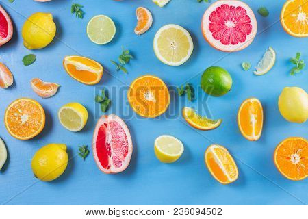 Citrus Slices Food Pattern On Blue Background - Assorted Citrus Fruits With Mint Leaves