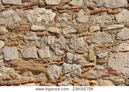 Background Of Brown, Beige And Gray Stones. The Old Wall Of Stones. Ancient Ruins. Beige Background
