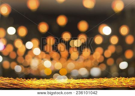 Happy New Year 2019 Concept: Long Exposure Of Candle Light With Golden Circle Bokeh At Night Backgro