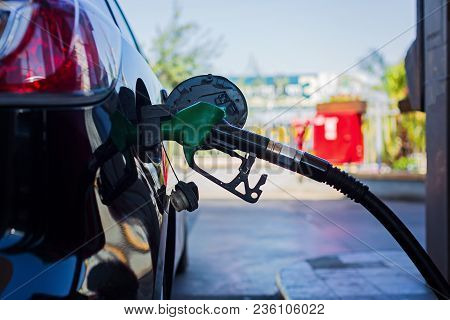 Car Refueling On Petrol Station. Fuel Pump With Gasoline. This Photo Can Be Used For Fuel Industry O