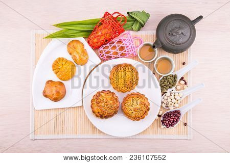 Mooncake For Chinese Mid-autumn Festival Celebration, Wih Ingredients And Tea On Table Top