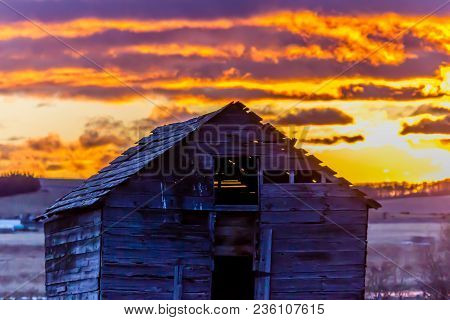 Stunning Sunrise Over A Rustic Out Building, Springbank, Alberta, Canada