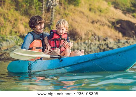 Father And Son Kayaking At Tropical Ocean. Travel And Activaties With Children Concept.
