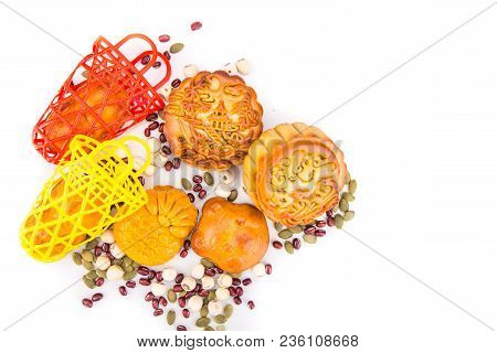 Mid Autumn Festival Chinese Mooncake  With Ingredients On White Background