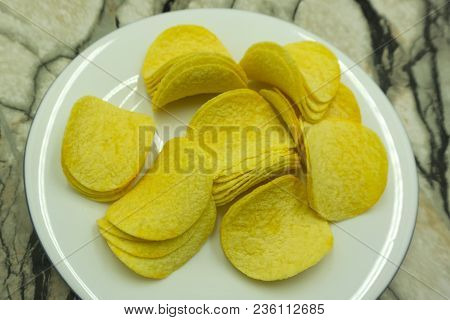 Potato And Potato Chips Isolated On White Background
