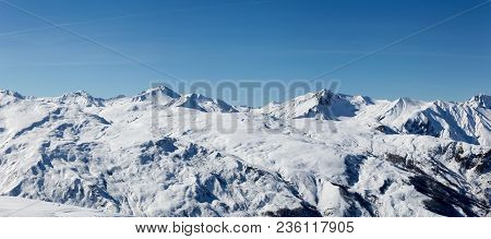 Landscape French Alps After A Snowfall, Haute Savoy, France. White Mountain And Blue Sky.
