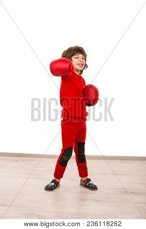 Cheerful Boy Showing Fist In Boxing Gloves Against White Background