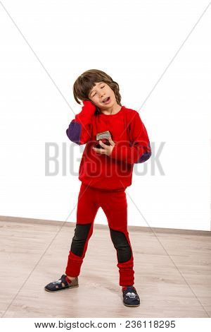 Cute Boy Standing And Imitate Sleeping With Musical Box In His Hands
