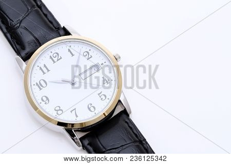 Close Up Of Wrist Watch With Leather Strap On White Background