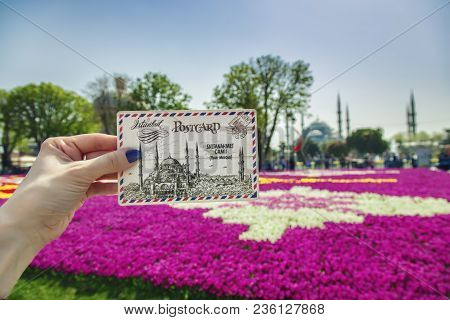 Istanbul, Turkey: Female Hand With A Postcard Depicting The Sultanahmet Mosque And Sultanahmet Mosqu