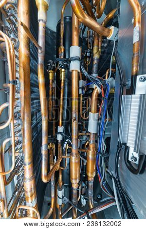 Internal Arrangement Of The Industrial Air Conditioner. Many Copper Brazed Tubes. Climatic Appliance