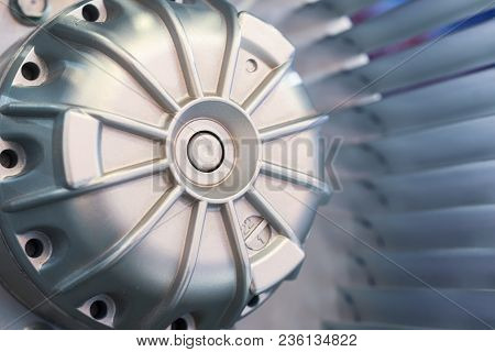 Motor And Blades Of The Impeller Of An Industrial Fan. Close-up. Abstract Industrial Background.