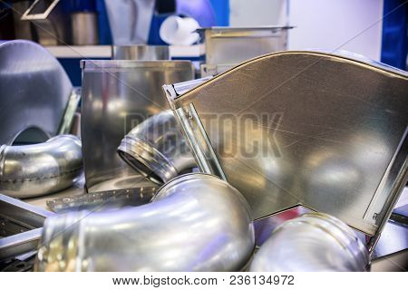 Metal Ventilation Ducts. Accessories For Repair Of Ventilation Systems. Abstract Industrial Backgrou