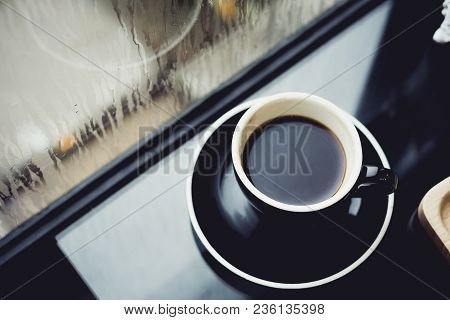 Black Coffee Cup On Table In Cafe Restaurant Near Window When Raining In Garden Outside Shop,food An