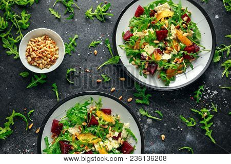 Fresh Beet, Orange Salad With Wild Rocket, Cheese And Pine Nuts. Healthy Summer Food.