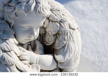 Sleeping Angel Statue.angel Guardian Sleeping In White Snow Background