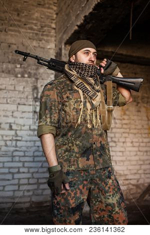 Portrait Of Serious Middle Eastern Man With Ak-47