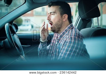 Bored And Tired Yawning Man Driving His Car Need A Rest