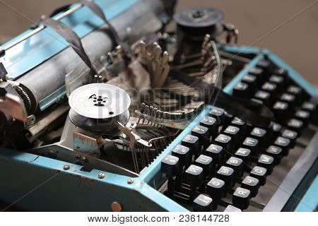The Old Typewriter In Beams Of The Sun. In Natural Lighting, In Light From A Window. Retro Style. Ol
