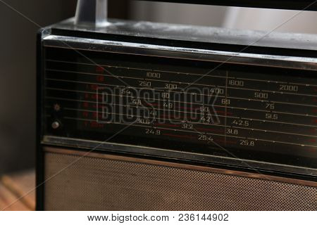 Old Radio Stands On A Wooden Table Near A Window. Nostalgia. Old Times. Road To The Past