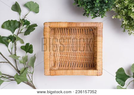 Wicker Basket With Foliage Flat Lay Top View