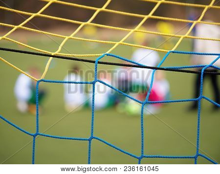 Football Training.  Crossed Soccer Nets Soccer Football In Goal Net With Grass On Outdoor Playground