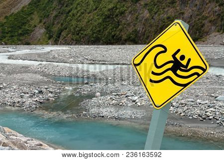 Sign Showing Drowning Man In River Warning Against Flash Floods